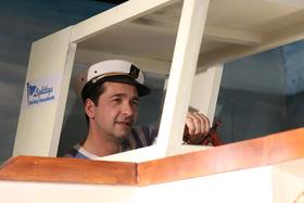 Bild: Drei Mann in einem Boot