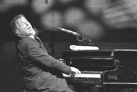 """An Evening of Sir Elton John´s Greatest Hits  One Piano - """"One Voice"""" performed by Donovan Aston"""