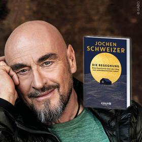 """Bild: Jochen Schweizer im Gespräch zu """"Die Begegnung"""" - Eine Geschichte über den Weg zum selbstbestimmten Leben"""